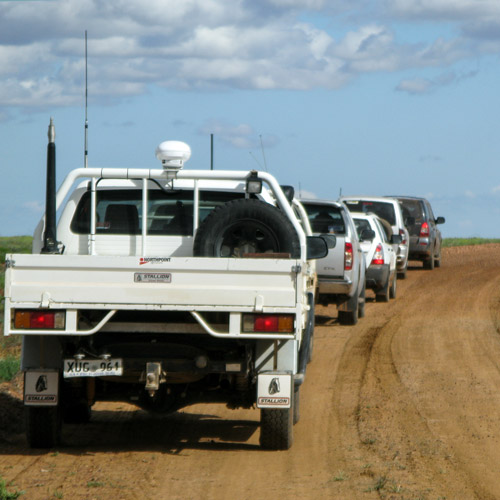 Vehicles heading to dig site
